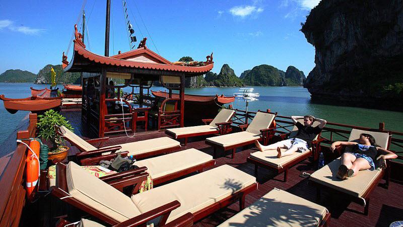Halong bay cruise - relaxing on sun deck of Phoenix cruise