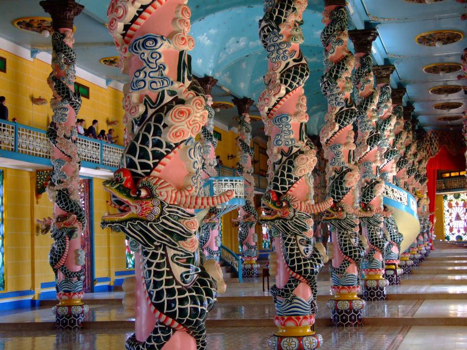 CaoDai temple with dragon pillars