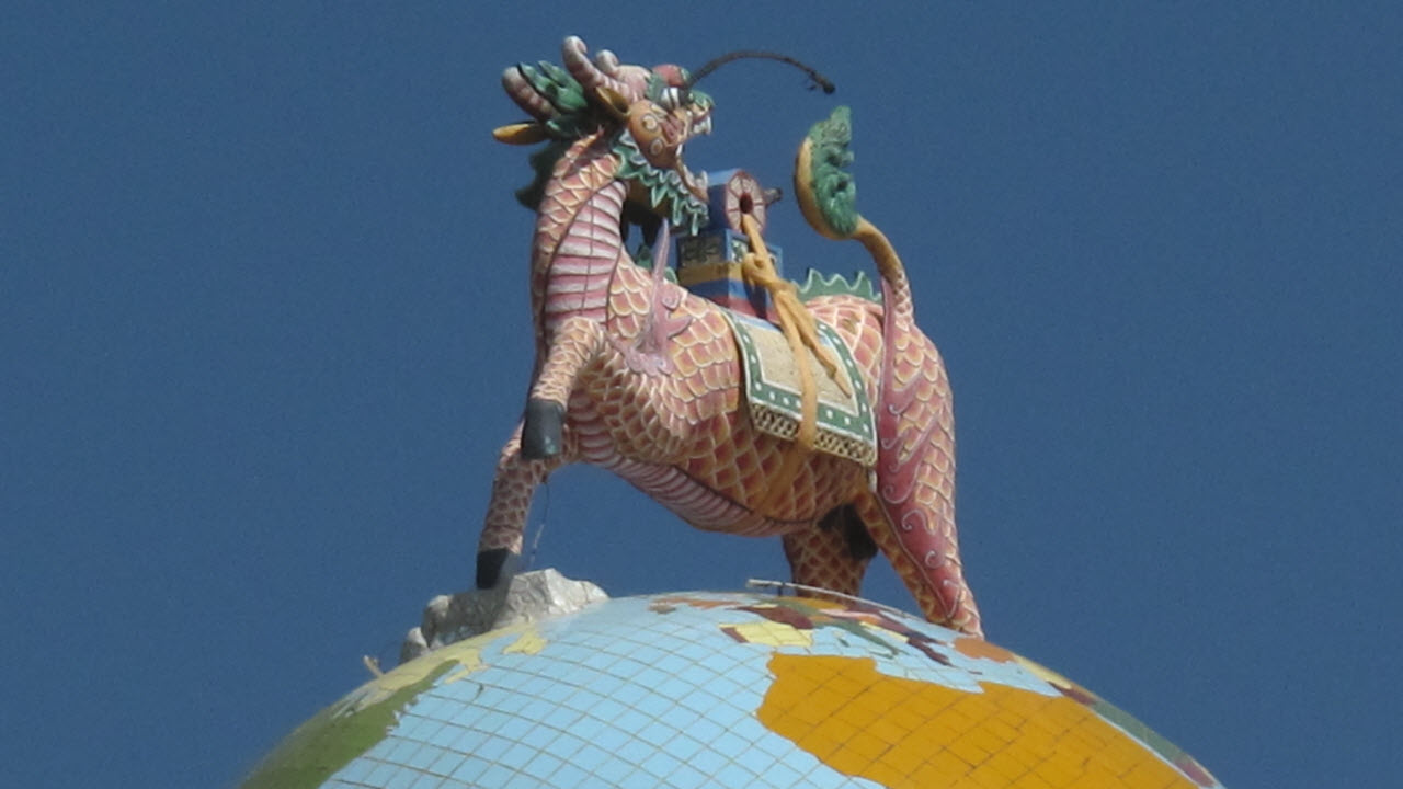Cao Dai temple - Dragon horse LongMa standing on the globe